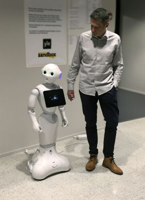 Ceiton CEO Bernd Krechel meets AI Pepper at customer Yle